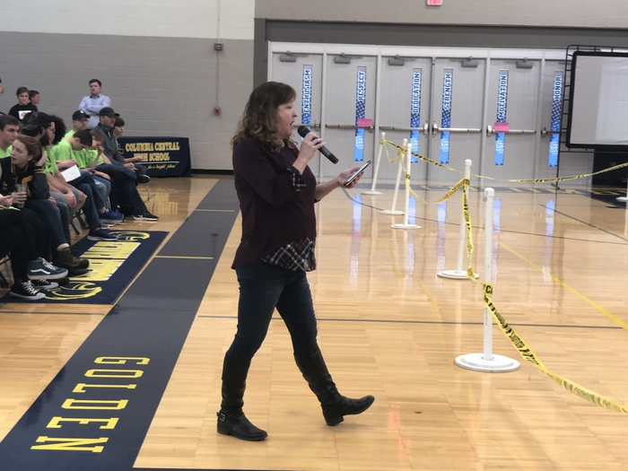 Ms. Hogel welcomes the competitors