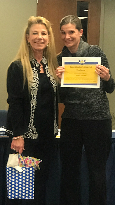 Dr. Campbell gives Mrs. Eastman the Superintendent's Award of Excellence!